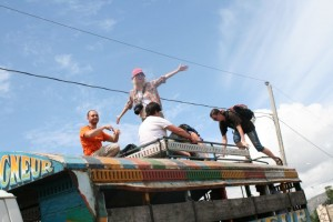 Riding in the luggage rack on top of a bus in Haiti